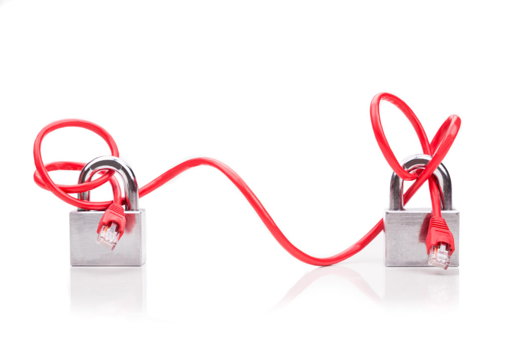 Concept of computer network security with end to end padlock over network cable on white background